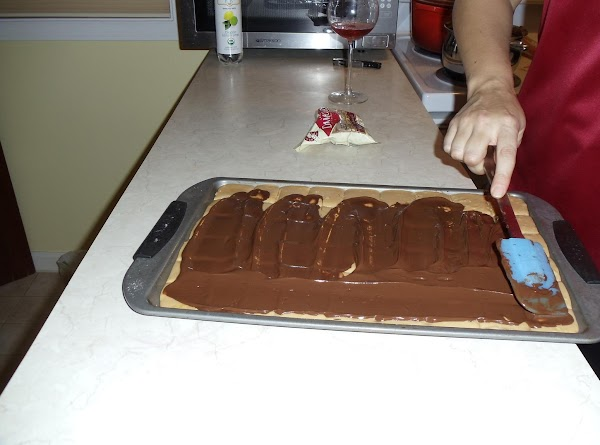 Pour melted chocolate mixture over almond mixture and spread evenly.
