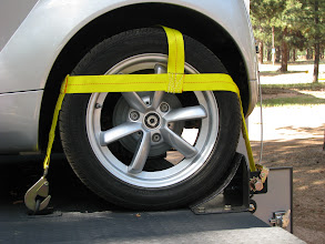 Photo: These are custom wheel nets. The chocks and wheel nets worked out very well. The chocks are removable - which was a design goal. The wheel nets do not interfere with any of the cars brake lines (on the inside).