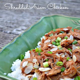 Slow Cooker Shredded Asian Chicken Over Jasmine Rice.