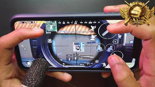 image of two hands holding a mobile phone with a video game on the screen