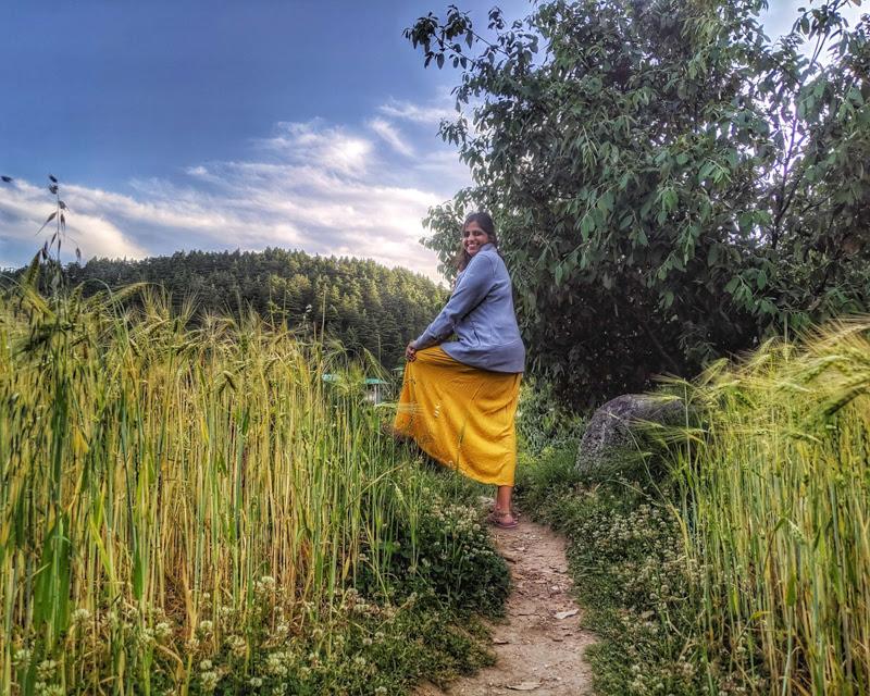 girl+walking+in+bhagsunag+beautiful+villages+in+himachal+pradesh