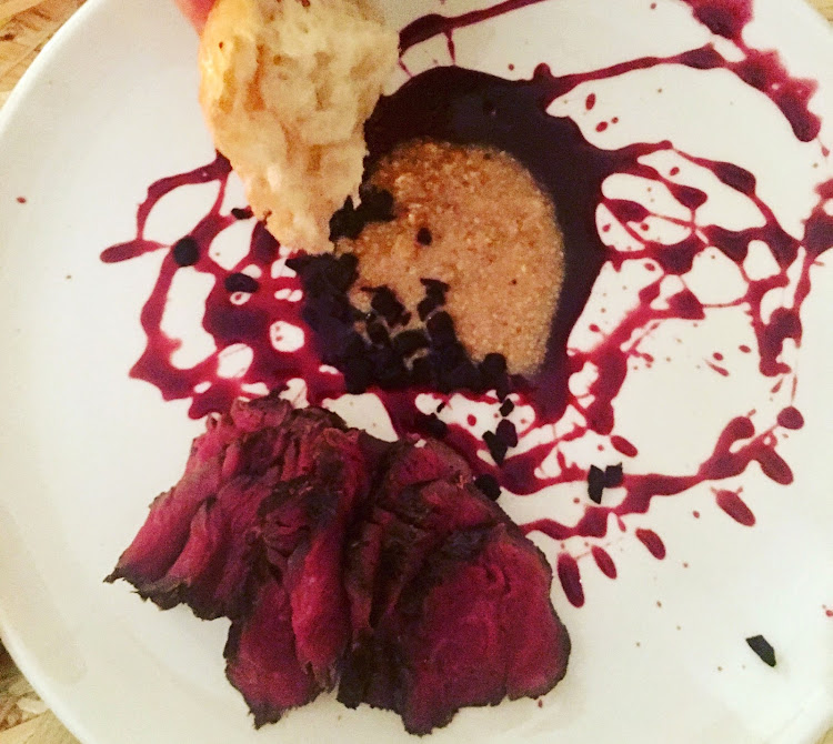 Semi-dried beef biltong with smoked beetroot and hazelnut praline, beef fat focaccia and garlic butter
