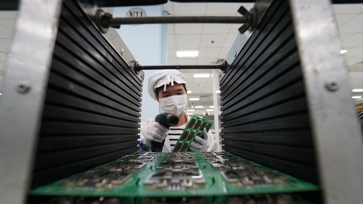 Worker assembling product parts