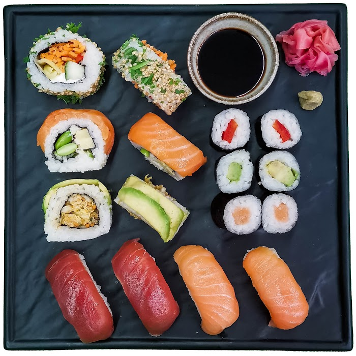Square black tray with artfully laid out sushi
