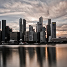 by Richard Amar - City,  Street & Park  Skylines ( clouds, canon, cityscape, big stopper, singapore, marina bay, city, urban, cbd, 7d, 17-40mm, sunset, lee nd filter, tension )