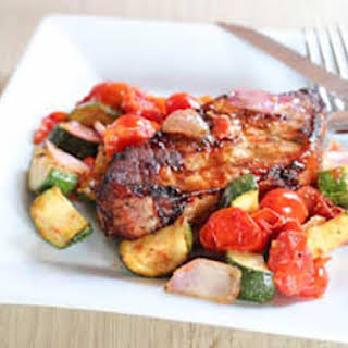 Grilled Pork Chops with Tomato and Zucchini.
