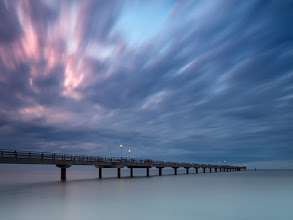 Photo: Prerow, Germany  I just came back from a short scouting trip to Baltics. This is where I guess I have the closest path to the sea - Eastern Germany. I like what I found over there so planning to go back for couple of days before the year end. Stormy weather, long piers and other wooden sticks in sea waters is what made it long exposure times weekend. Here's the pier in Prerow early in the morning when I tested long exposures on my Phase One IQ140 digital back (it's said not to handle anything over couple of seconds). I exposed for a minute plus 4 secs and although it slightly increased noise, Capture One raw processor eliminated it fully. Colors came out nicely, catching a little bit of the rising sun glow on the left. The contrast between extremely calm water and the windy sky has been a tempting element to try out...