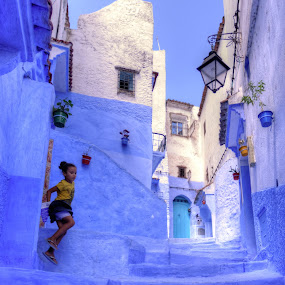 Chefchaouen by Tariq Ouhti - City,  Street & Park  Street Scenes ( flying girl, cat, it, simple, nice, blue city, bleu, morocco, la cité bleue, blue, d90, nikon, maroc, keep )