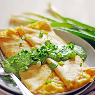 Scrambled Egg Breakfast Crepes with Spinach Sauce.