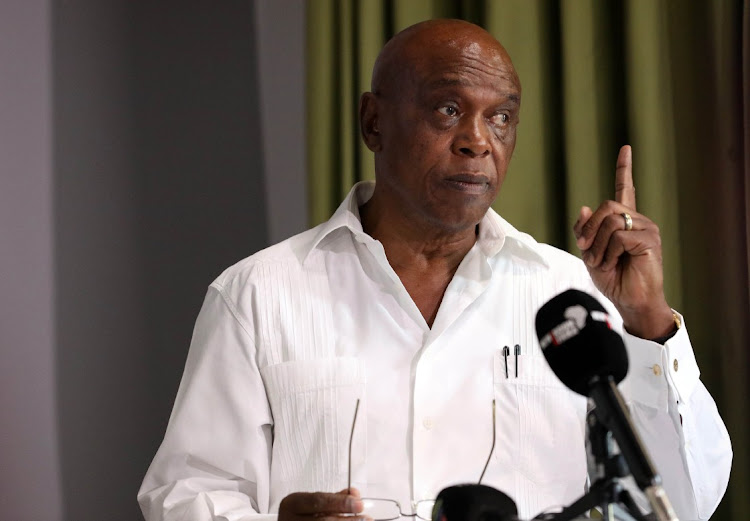Tokyo Sexwale addresses the media.