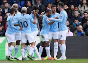 Manchester City's Raheem Sterling celebrates scoring their first goal with team mates.