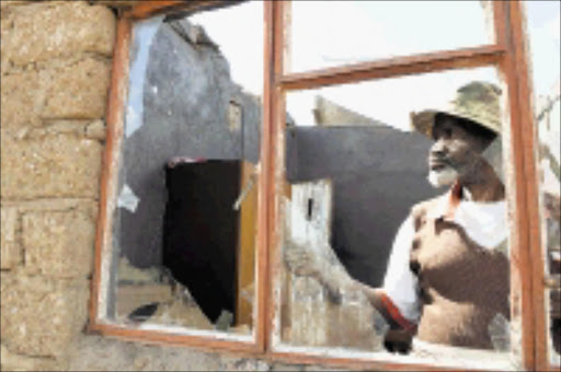 NO HOUSE: Wilson Maluleke inside his roofless one-roomed house at Mohodi GaManthata village in Limpopo. 11/05/09. PIc. Elijar Mushiana. © Sowetan.