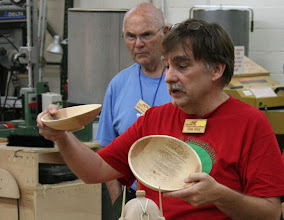 Photo: Tim Aley shows a pair of willow oak bowls that were still a little wet when turned.