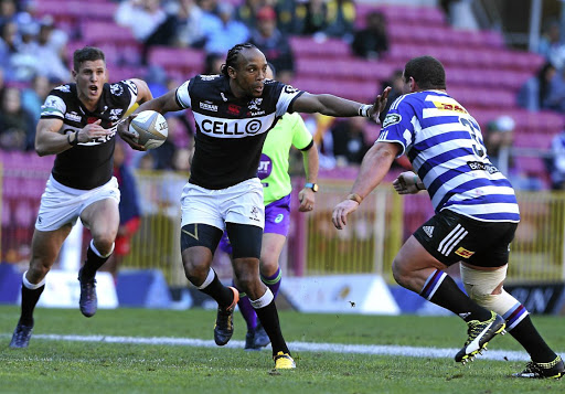 True grit: Odwa Ndungane hands off a Western Province player in a Currie Cup match in August. Saturday's match against the same opposition in Durban will serve as Ndungane's tribute match before he retires at the end of October. Picture: GALLO IMAGES