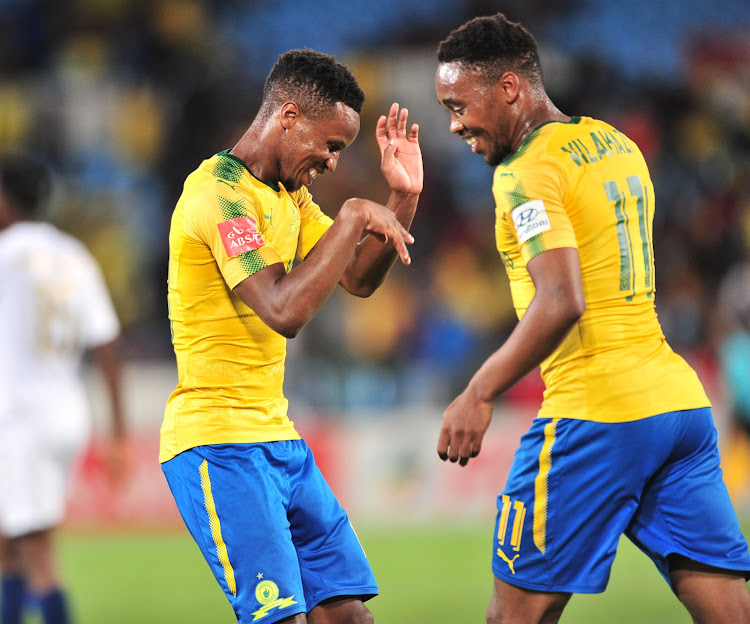 Mamelodi Sundowns midfielders Sibusiso Vilakazi and Themba Zwane celebrate after the pair scored both goals in a 2-0 Absa Premiership win over Bidvest Wits at Loftus Stadium in Pretoria on Saturday April 14 2018. With the win, The Premier Soccer League leaders Sundowns stretched their lead over second placed Orlando Pirates to six points with four matches remaining.