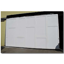 Photo: Large, lightweight, insulated factory door made of Torsion Box Honeycomb Sandwich Panels. 12 ft x 20 ft.