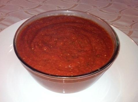 Get a large sauce pan and empty the tomato puree,and 2 cans of tomato...