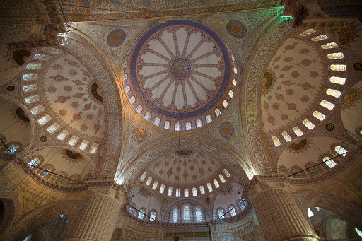 Interior of the ornate Sultan Ahmed Mosque, or Blue Mosque, in Istanbul, Turkey.
