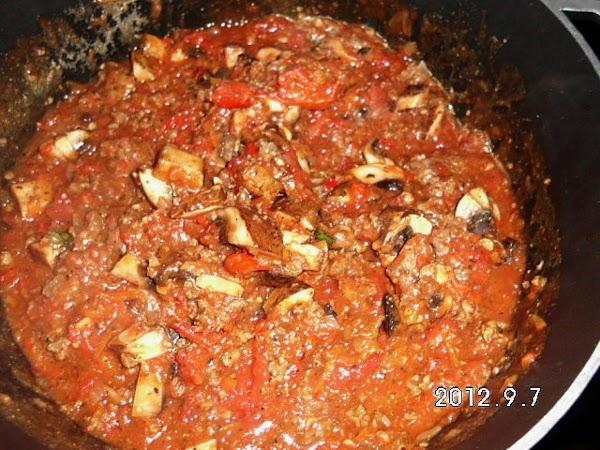 Add whole tomatoes, tomato sauce, chopped portabello mushrooms, Italian seasoning, sugar lemon juice and...