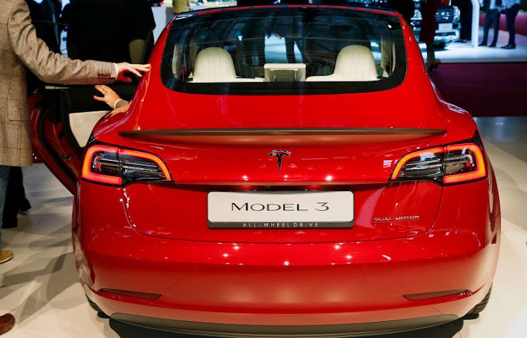 A Tesla Model 3 automobile is on display during the first press day of the Paris Motor Show on October 2 2018.Picture:CHESNOT/GETTY IMAGES