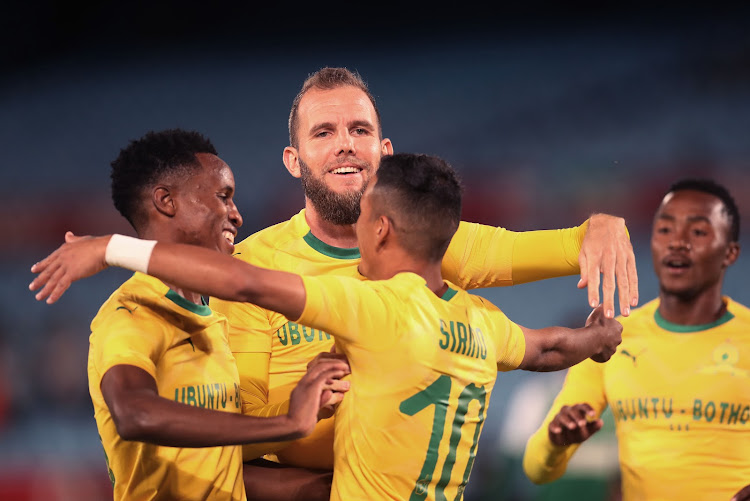Mamelodi Sundowns' New Zealand striker Jeremy Brockie (C) celebrates with teammates after scoring the opening goal in the 5-1 Caf Champions League group stage qualifying second leg match against Leones Vegatarianos at Loftus on December 5 2018. Sundowns won 71 on aggregate.