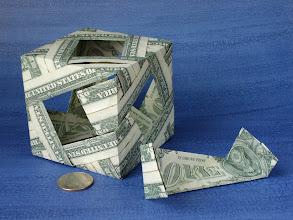 Photo: Model: Decoration Box Modular Cube;  With 1 module removed;  Creator: Bennett Arnstein;  Folder: William Sattler;  12 dollars total;  Publication: Modular Origami Polyhedra (Bennett Arnstein, Rona Gurkewitz, Lewis Simon) ISBN 0-486-40476-5