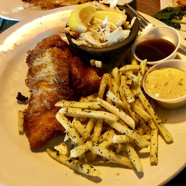 """fish n chips"" gf battered, fried cod with truffle, garlic fries. The tartar sauce was a little spicy and combined w/ the malt vinegar, made this was an absolutely amazing feast"