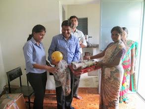 Photo: Gandhigram Balwadi -- Jenifer and Kaushal giving mats to the teacher.