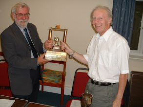 Photo: Nick Wingfield presenting Tony Ransom with Wiltshire 4-Side trophy for Trowbridge - winners of 2011/2012 season.Wiltshire County Chess Association Executive Meeting,Langley Burrell Village Hall,Manor Farm Lane,Langley Burrell,Wiltshire.11th September 2012