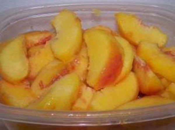 """Butter or Pam spray an 8"""" square baking pan.Preheat Oven @ 375.Slice peeled peaches..."""