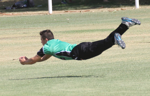 Nick Tomlinson takes a sensational catch for Crossroads Hotel second XI on Saturday against RSL at Leitch Oval to dismiss Pat Baker.