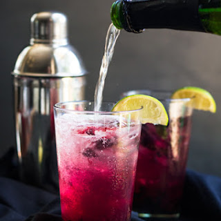 Blueberry Champagne Cocktail with Rum, Lime and Mint