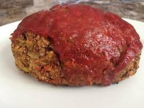 Pour tomato sauce over meatloaf; top with remaining cheese.  Continue baking 15 minutes.