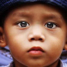 A Child's Stare by PATT LULUQUISIN - Babies & Children Child Portraits