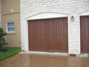 Photo: Another Wood Free door! This one comes in the factory painted walnut color with the clear cypress wood. Note the perimeter added for a more traditional look.