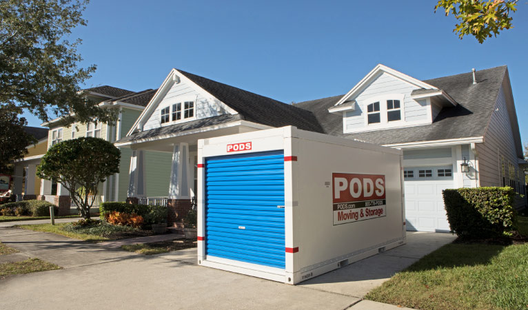 A PODS container in front of a home