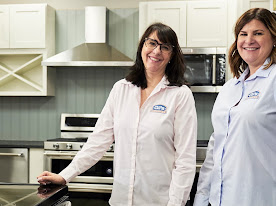 Two smiling women in the kitchen