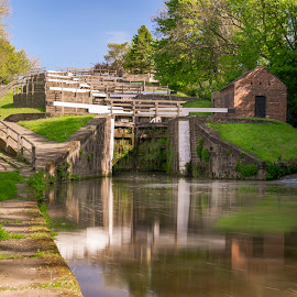Five Rise by Darrell Evans - Buildings & Architecture Other Exteriors ( sky, green, yorkshire, reflections, five rise locks, waterway, flora, walkway, locks, water, bingley, building, stone, outdoor, path, leeds and liverpool canal, uk, grass, plant, canal, no people, staircase, architecture, towpath )
