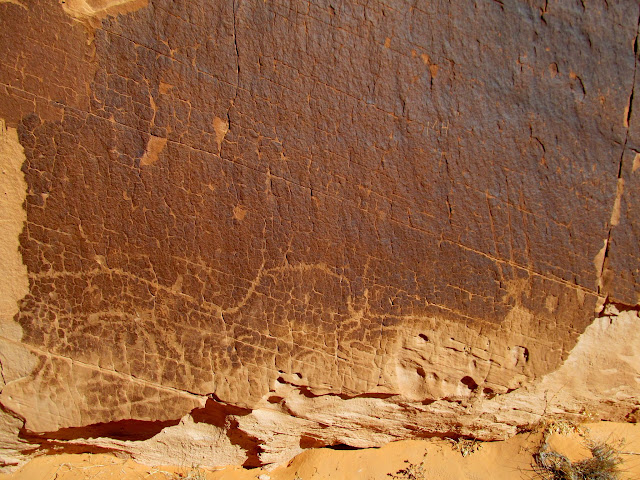 Low, weathered petroglyphs