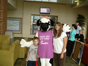 Photo: Speech Therapy child, Miss Cow and Speech Therapy graduate student.
