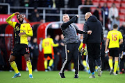 Nigel Pearson, Manager of Watford and Nathaniel Chalobah of Watford celebrate victory during the Premier League match between AFC Bournemouth and Watford FC at Vitality Stadium on January 12, 2020 in Bournemouth, United Kingdom.