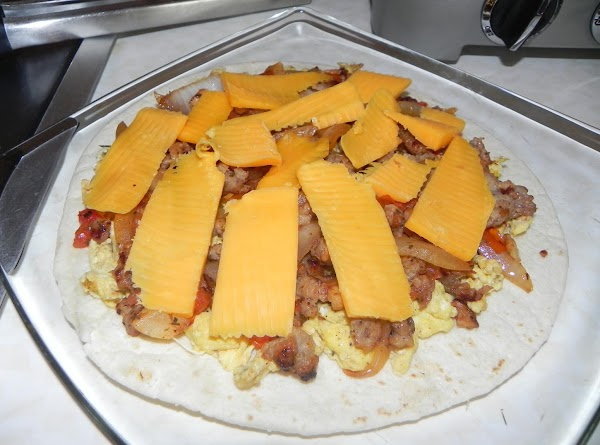 Add your slices of extra sharp cheddar cheese on top and then score the...