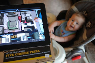 Photo: We used the Avengers AR App to see the 3D battle on the pizza box. It was pretty awesome.