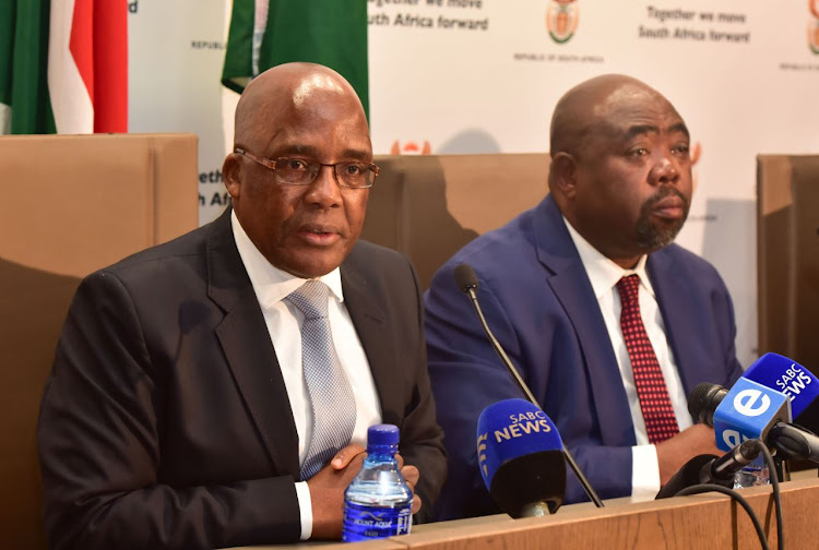Minister of Health Dr Aaron Motsoaledi and the Minister of Public Works Thulas Nxesi brief the media on an attempted burning down of the Civitas Building in Pretoria. Picture: SUPPLIED/GCIS