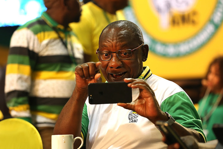 Cyril Ramaphosa making an animated face for a selfie while waiting to hear if he's the new president of the ANC at the party 54th electoral conference.