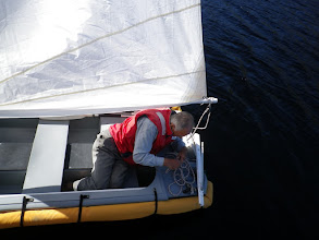 Photo: Captain rigging the dinghy