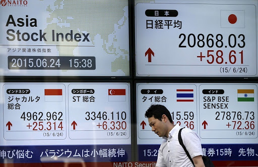 Asian stocks slip after Fed disappoints