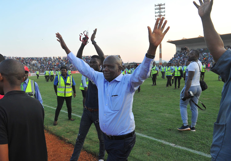 Black Leopards owner and chairman David Thidiela celebrate with the fans in the stands after his team won promotion to the Premier Soccer League (PSL) at Thohoyandou Stadium on May 30 2018.