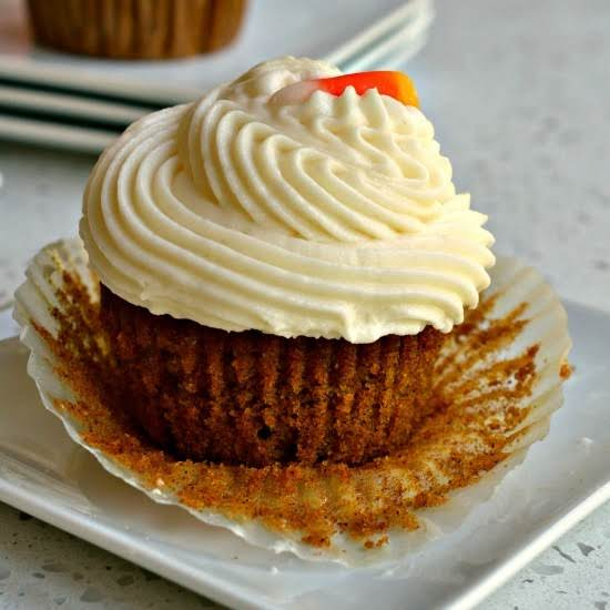 Easy To Make Moist Cinnamon Pumpkin Cupcakes With A Quick Four Ingredient Smooth Cream Cheese Frosting.  Make A Scrumptious Batch For Your Family Today.