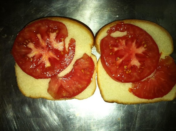 Place one large tomato slice on each slice of toast.  (If you don't...